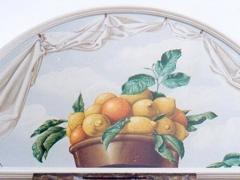 Lunetta con cesto di limoni e arance